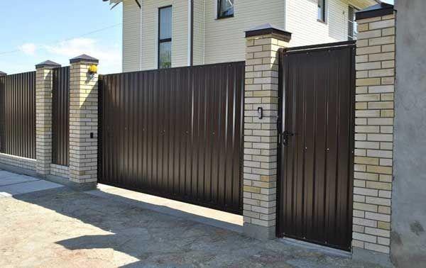 Откатные ворота: конструкция и особенности эксплуатации