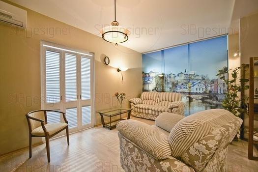 Небольшая перепланировка квартиры позволила сделать ее более просторной и светлой.