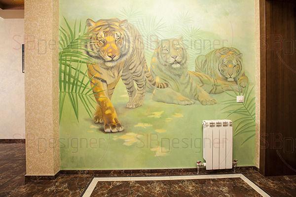 нарисованные на стене тигры