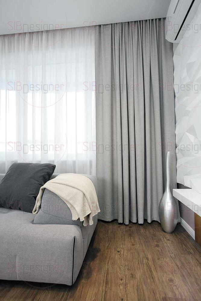 Акцентным цветом в колористике гостиной-кухни служит бирюзовый оттенок.