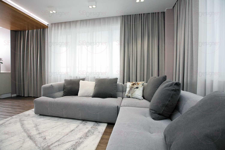 Зона отдыха выполнена преимущественно в серо-белом сочетании. Угловой невероятно уютный диван.