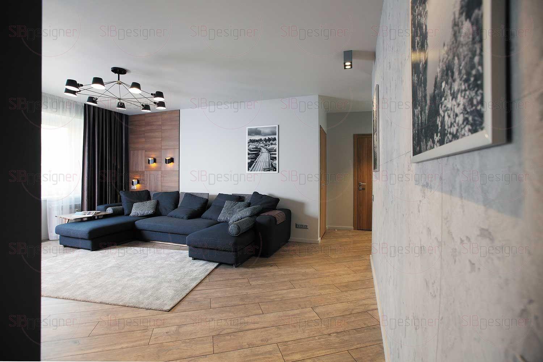 За стеной гостиной скрыта проходная гардеробная комната – нестандартное и очень удобное решение.