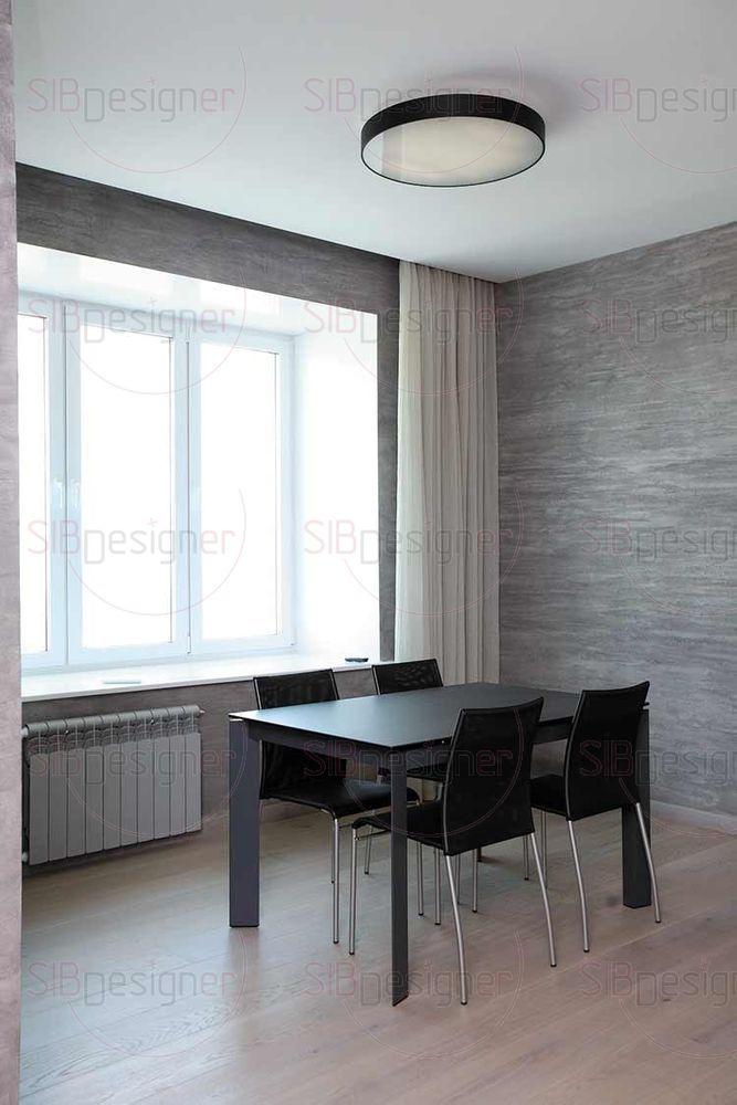 Уют минималистскому интерьеру придают и натуральные текстуры тканей – в обивке мягкой мебели и в виде лаконичных штор.