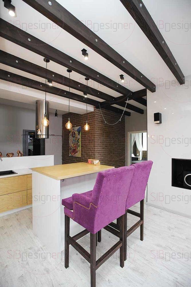 Чтобы избежать ощущения замкнутости, дизайнер не стала отгораживать стеной зону кухни от коридора.