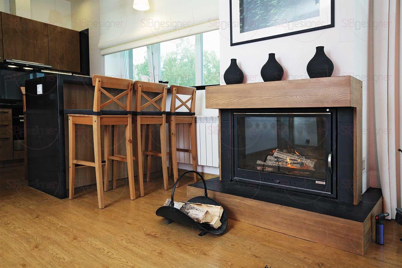 Сердце дома – гостиная, совмещенная с кухней. Визуальной границей между ними служит барная стойка, которая является также обеденным столом.