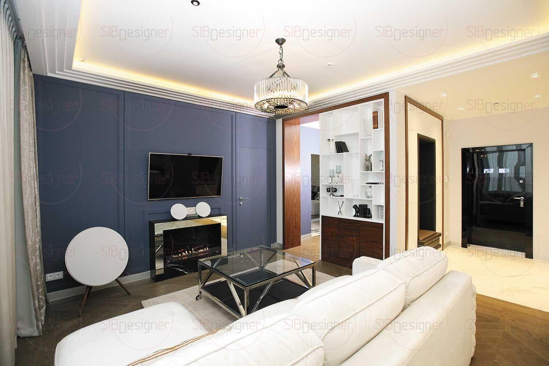 В гостиной царит спокойная глубокая атмосфера, благодаря прежде всего доминанте в виде стены сложного синего оттенка.