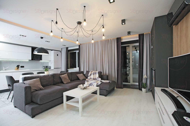 Гостиная визуально отделена от кухни не только отдельной плоскостью потолка с подсветкой, но и материалом напольного покрытия.
