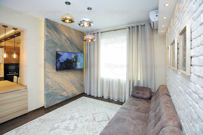В гостиной отделка под белый кирпич органично сочетается с другими элементами оформления и добавляет помещению визуального колорита.