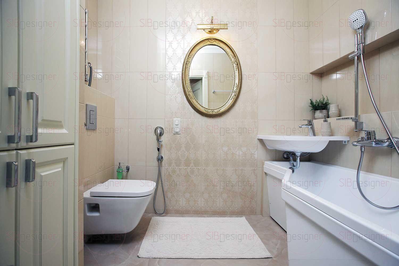 В общем стиле выдержан и интерьер ванной комнаты, стены и пол которой отделаны крупноформатной плиткой с перламутровым блеском. Усиливает впечатление большое круглое зеркало в массивной золоченой раме на стене.