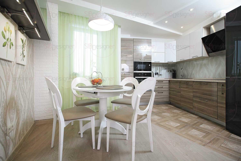 Кухня разделена на зону готовки и обеденную .