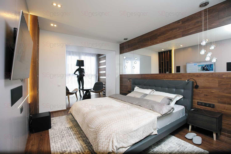 Над изголовьем большой двуспальной кровати – длинное зеркало во всю стену, в котором отражаются элегантные подвесные светильники.