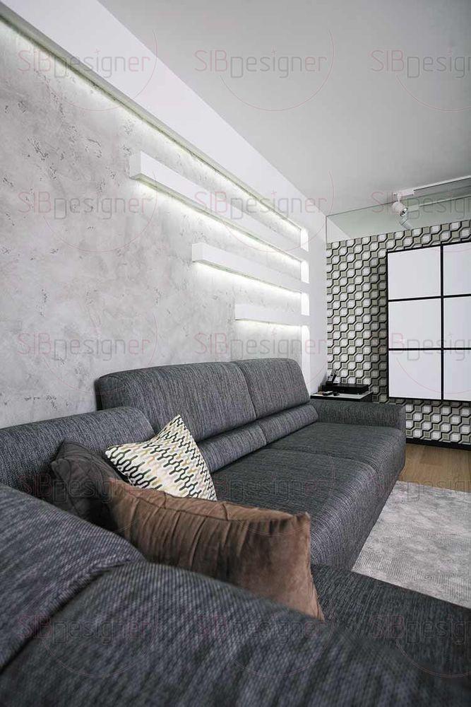 Световое оформление гостиной довольно богатое. Здесь и потолочный светильник, и торшер, инсталляция на стене и споты на потолке.