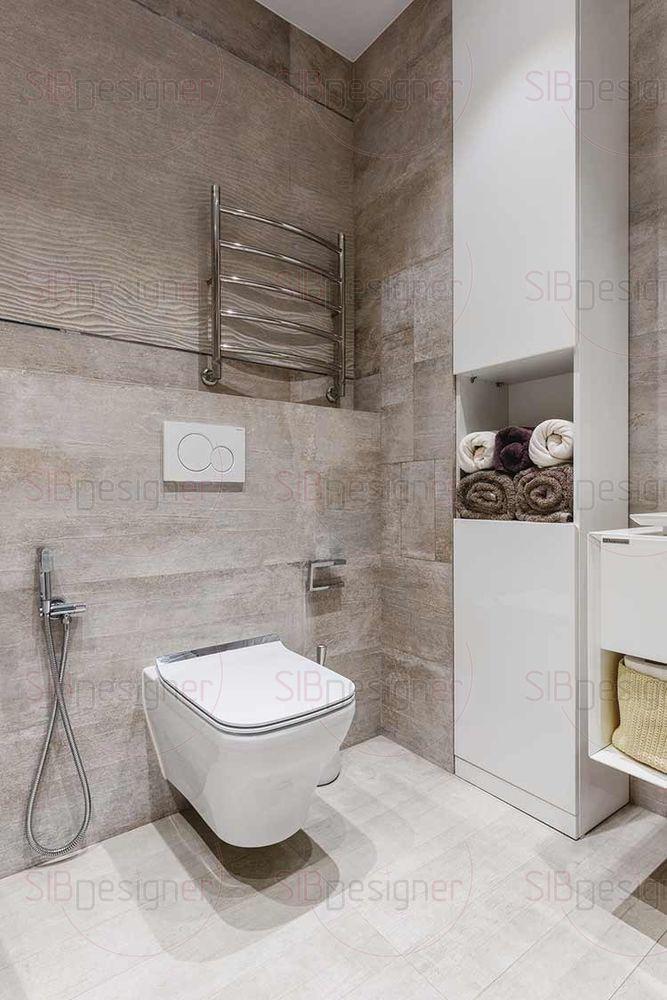 В ванной комнате есть и душевая кабина, и ванна. Как и в остальных помещениях, там имеются встроенные шкафы – все пространство задействовано рационально.