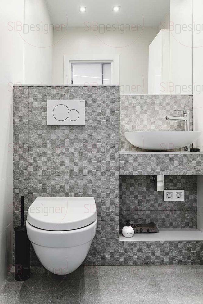 Ванная комната оборудована современной сантехникой.