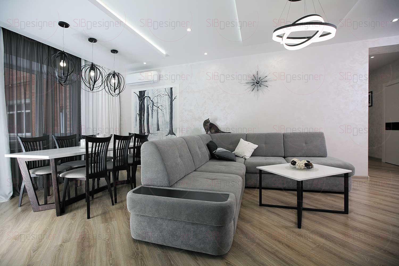 Благодаря дневному освещению в гостиной особенно заметен контраст белого и холодных серых.
