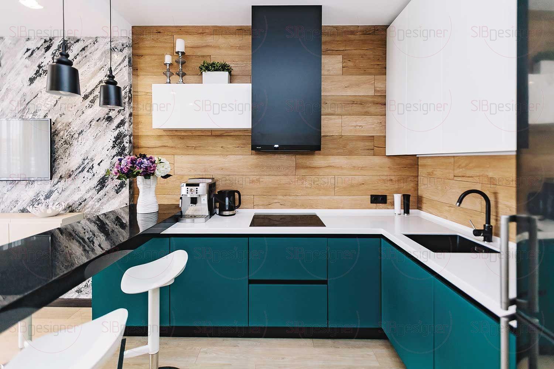 В дизайне кухни авторы проекта по-бунтарски отказались от симметрии и типичных решений.