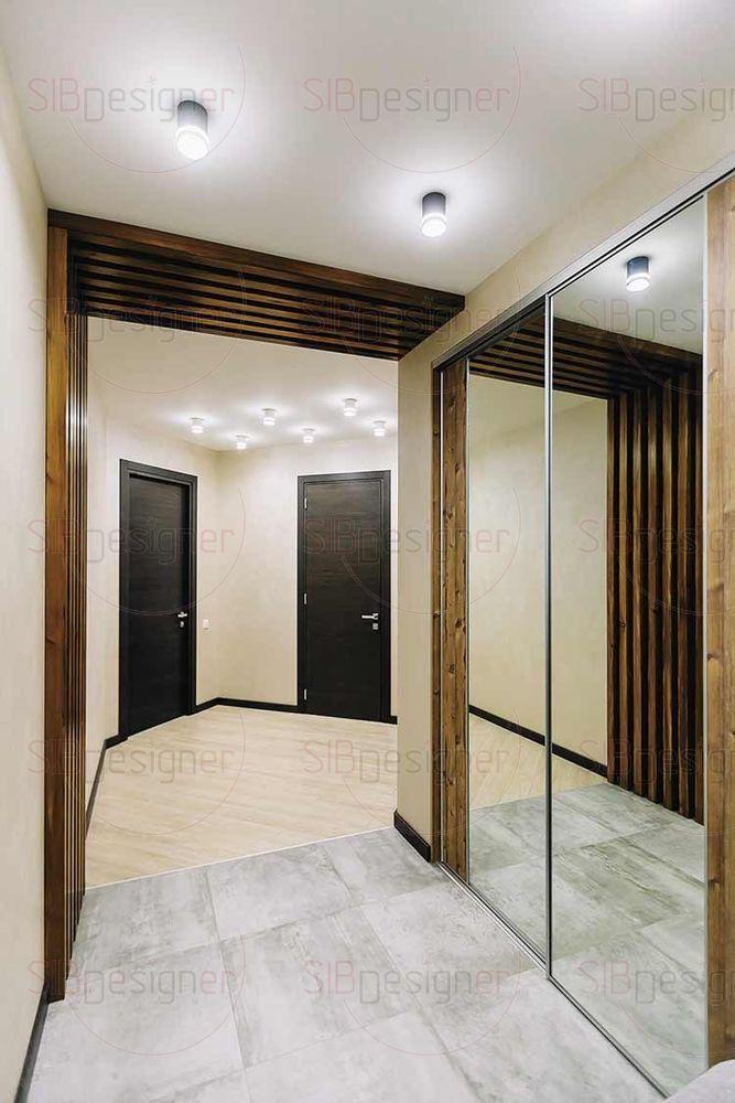 При небольшом бюджете дизайнеры не стали экономить на дверях, отдав предпочтение эффектному варианту высотой 2300 см. Такие модели масштабируют пространство, создают иллюзию просторного помещения.