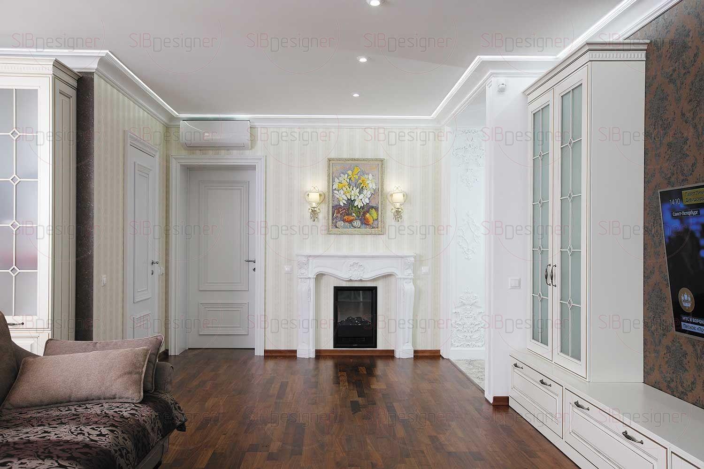 Нефункциональная стена в гостиной была приспособлена под электрический камин с гипсовым порталом – прекрасный символ домашнего очага.