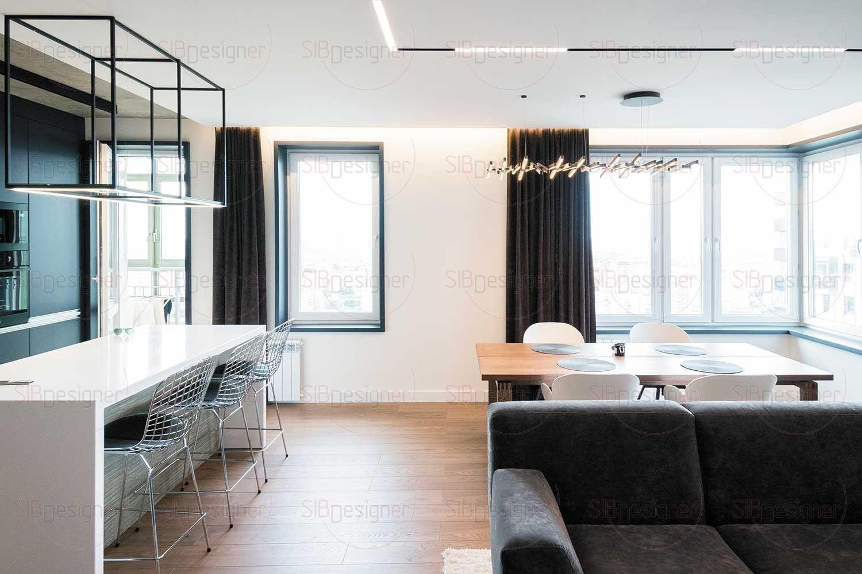 На потолке над диваном и обеденным столом – светильники на магнитном шинопроводе.