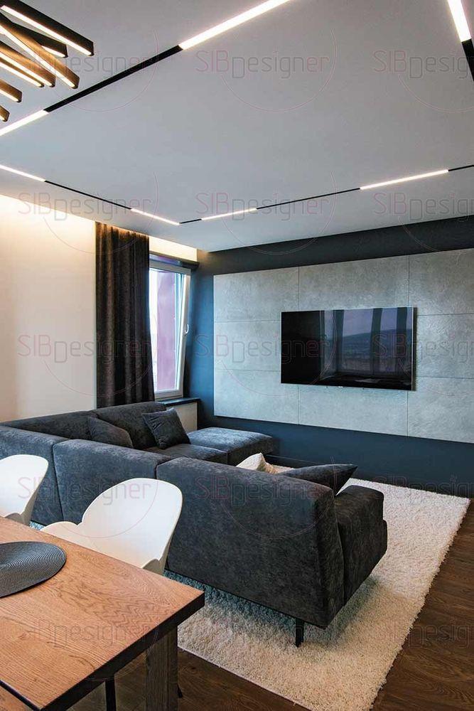 Напротив стены с телевизором находится большой удобный диван, на котором может разместиться компания друзей.