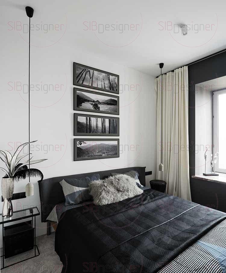 Интерьер спальни практически монохромный. Ряд постеров над изголовьем и подвесные светильники выстраивают ритм вертикалей, разбивая объем белой стены. Интерьер при своей строгой гамме и графичности производит впечатление уютного, он смягчен мягким ковролином.