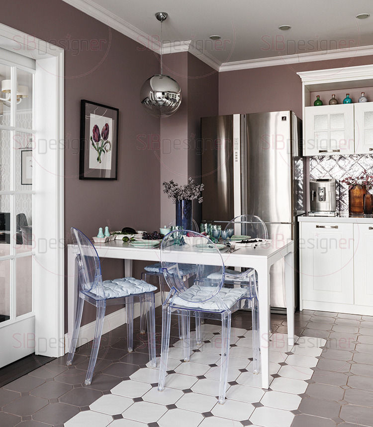 Пол на кухне выложен матовой серой плиткой классической формы. Обеденную группу украшает белый «ковер», который удачно зонирует комнату.