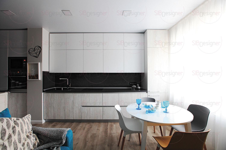 Зоны кухни и гостиной изначально были объединены в одно пространство. Кухня представляет собой квинтэссенцию функциональности, притягивая внимание своим минималистским дизайном