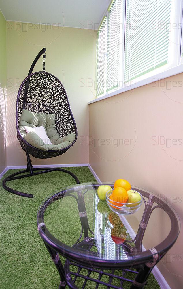 В лоджии, объединенной со спальней, оборудовали место для отдыха
