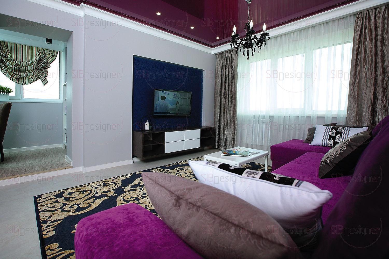 Уравновешивает яркую мягкую зону в гостиной зона TV, размещенная напротив